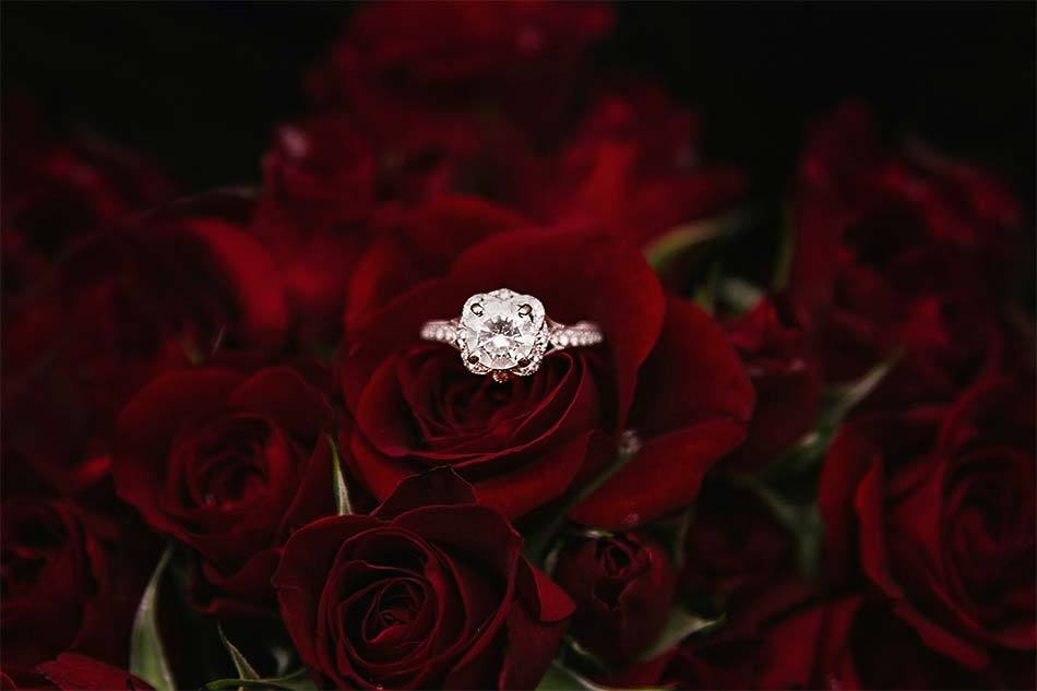 diamond ring and red roses