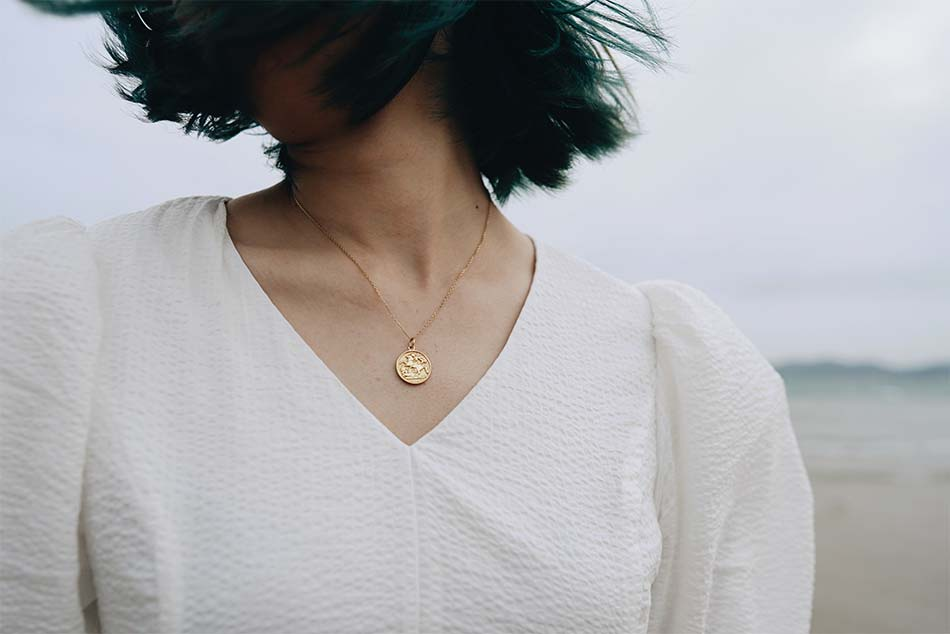 girl with a beautiful pendant