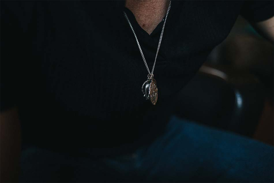 man with a pendant