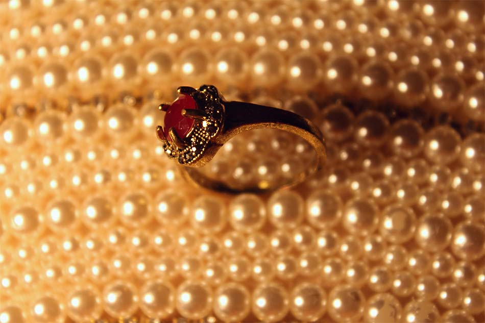 red gem in a ring