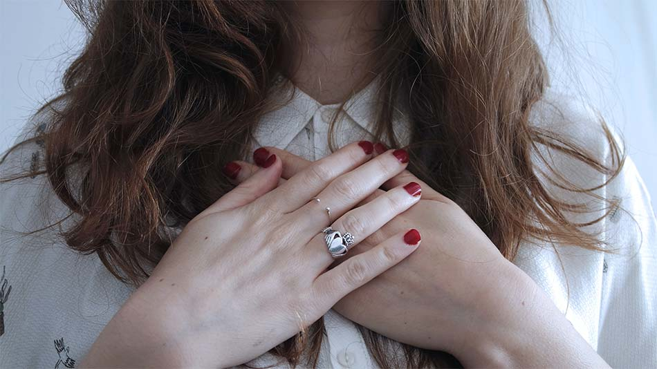 two hands with rings