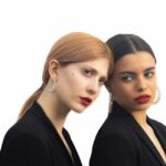 two women with red lips