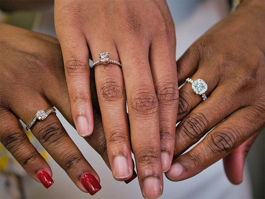engagement rings on three hands