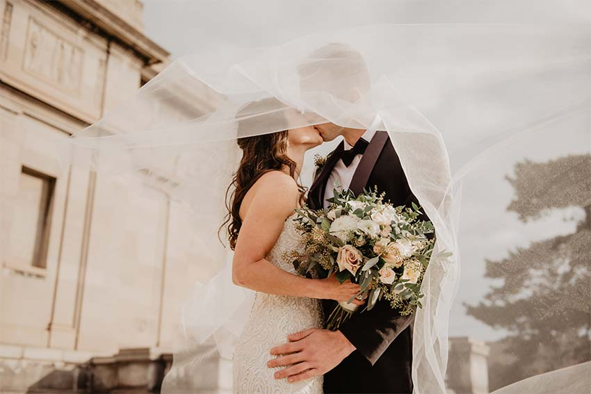 kiss between a bride and a groom
