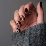 hand with dark nails